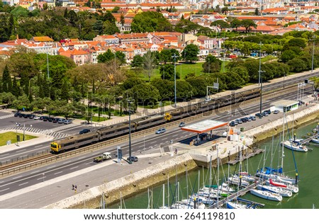 Suburban train passing by a street of Lisbon - Portugal - stock photo