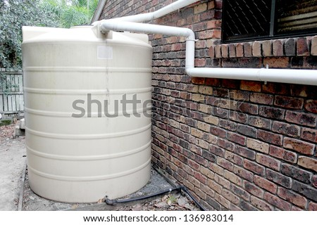 Suburban Water tank 1 - stock photo