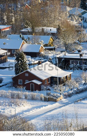 Suburd detached house at wintertime  - stock photo