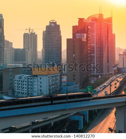 subway and modern city at dusk in shanghai - stock photo