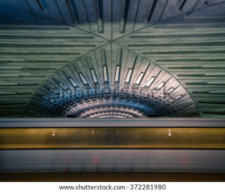 Subway blur and dramatic vaulted ceiling of the Washington DC metro station - stock photo