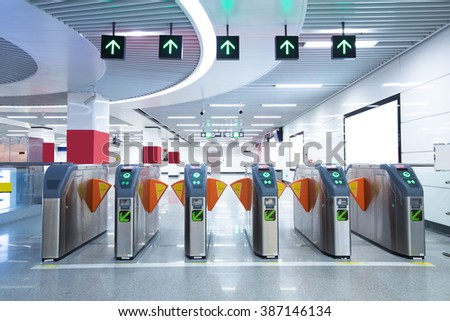 Subway station pedestrian access gates - stock photo