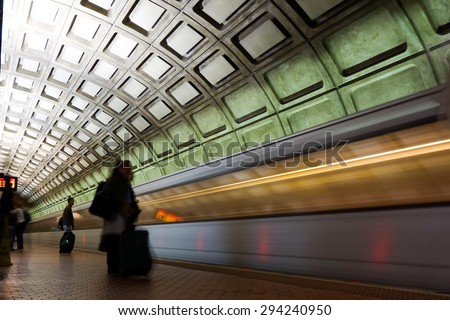 Subway station with passengers and train in motion blur - Washington DC, United States  - stock photo