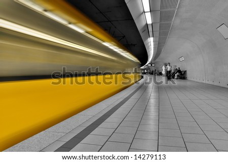 subway station with train in motion
