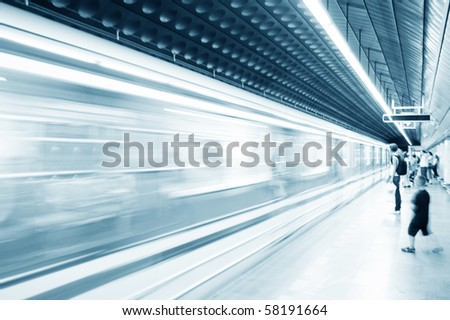 Subway train pulling into the station. Motion blur picture. - stock photo
