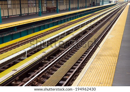 Subway train station scene in New York City - stock photo