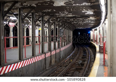 Subway tunnel in New York City subway. - stock photo