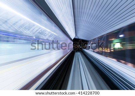 Subway tunnel with blurred light tracks