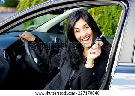 Succesful woman with brand new car - stock photo