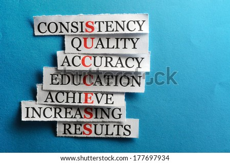 Success  acronym  in business concept, words on cut paper hard light - stock photo