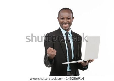 Success African businessman with laptop