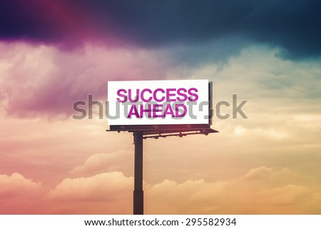 Success Ahead Motivational Message on Outdoor Advertising Billboard Hoarding Against Cloudy Sky - stock photo