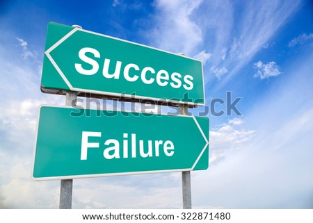 success and failure on green road sign with blue sky, business concept - stock photo