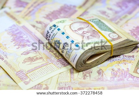 Success and got profit from business with 500 banknotes of indian rupee currency,money,Focus on eye of Gandhi - stock photo