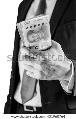 Success and got profit from business with businessman holding Chinese yuan currency,money in a hand,Focus on eye of Mao zedong with black and white color - stock photo