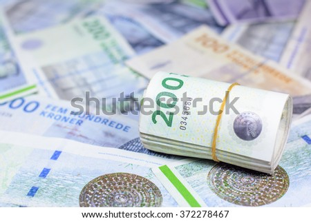 Success and got profit from business with colorful of danish krone currency,money,Focus on number 200 of money roll