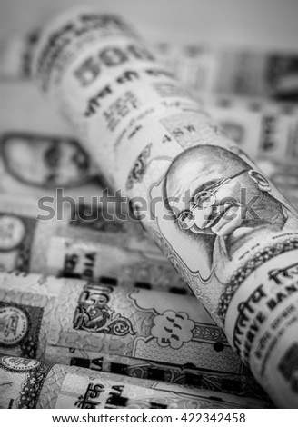 Success and got profit from business with indian rupee currency,money on black and white color,Focus on eye of Gandhi