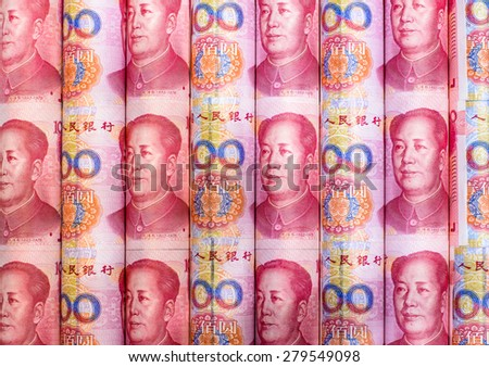 Success and got profit from business with roll China yuan currency ,money banknote on red color - stock photo