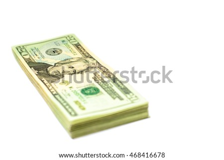 Success and got profit from business with twenty american dollar isolated on white background,Focus on eye of a man on banknote with copy space