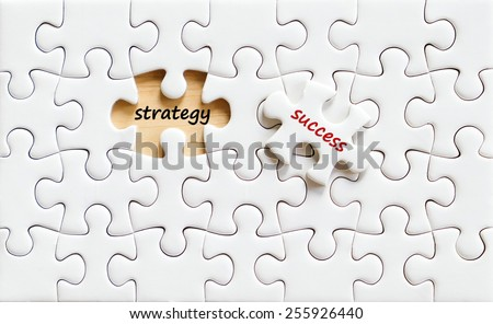 Success and strategy words on jigsaw puzzle,business background - stock photo