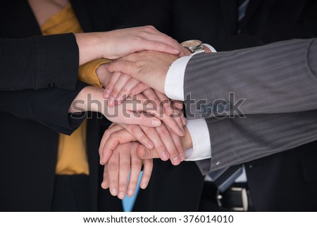 success and winning concept happy business team in office - stock photo