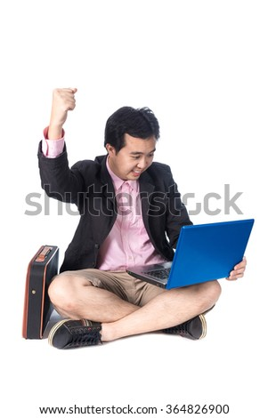Success Asian businessman rejoicing with laptop,  fists arms in air, smiling and shouting in, isolated on white background