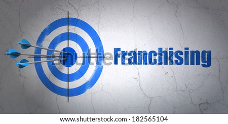 Success business concept: arrows hitting the center of target, Blue Franchising on wall background, 3d render - stock photo