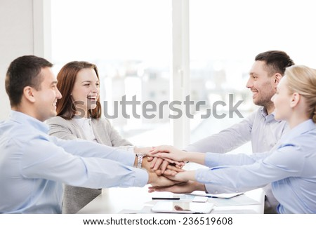 success, business, office and winning concept - happy business team celebrating victory in office - stock photo