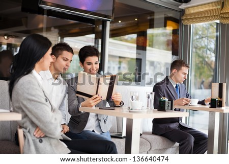 success business team on break in cafe - stock photo