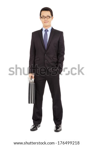 success businessman holding briefcase over white background