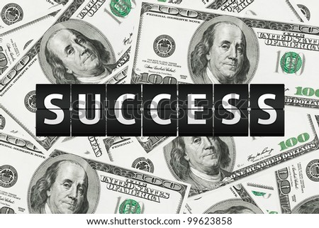 Success concept. Flipping Sign on a money background - stock photo
