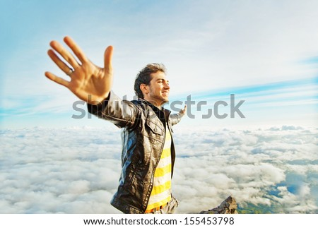 success concept - man on the peak of mountain - stock photo