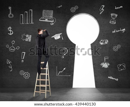 Success concept with businessman on ladder looking through keyhole shaped door in concrete room with business charts on wall. 3D Rendering