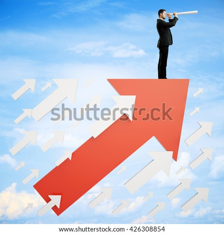 Success concept with businessman on red arrow looking into the distance on sky background