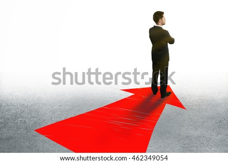 Success concept with businessman standing on large red arrow