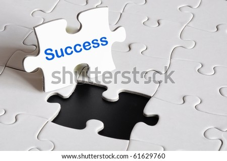 success concept with white puzzle or jigsaw - stock photo
