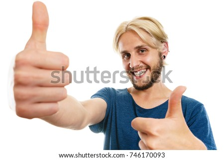 Success concept. Young college student giving thumb up hand sign gesture, isolated on white