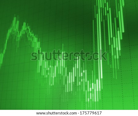 Success graph on green background. Stock trade on computer screen.