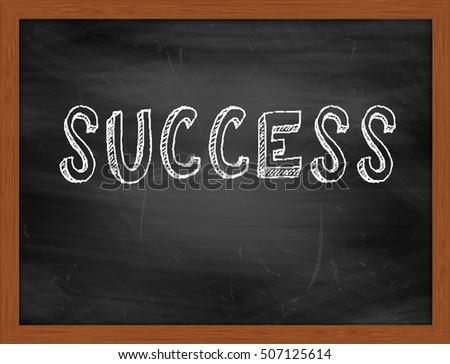 SUCCESS hand writing chalk text on black chalkboard
