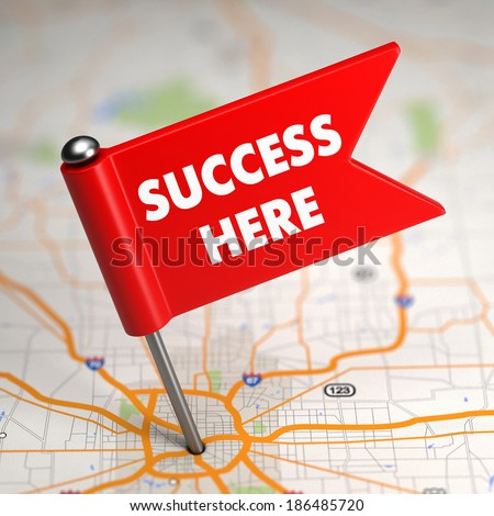 Success Here - Slogan on Red Small Flag Sticked in the Map Background with Selective Focus. - stock photo