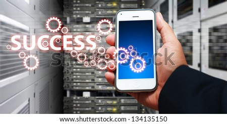 Success icon from smart phone - stock photo