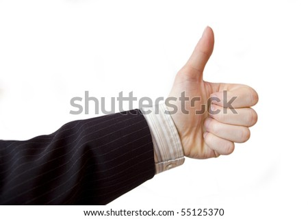 Success in business. Businessman hand shows the sign of victory.