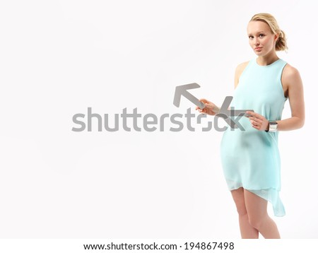 Success in business .Elegant young woman pointing with silver arrows.  - stock photo