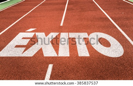 Success (in Spanish) written on running track