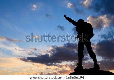 success in the sunset - stock photo