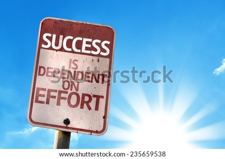 Success is Dependent on Effort sign with sky background - stock photo