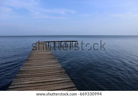 Success Isn't a Straight Line - Wooden Boardwalk over Sea