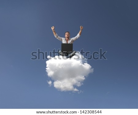 Success of a businessman over a cloud - stock photo