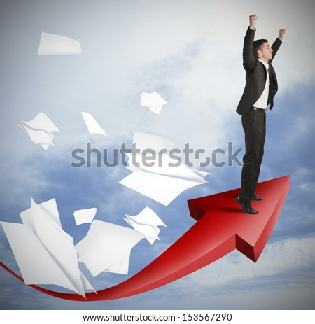 Success of a businessman with positive statistics - stock photo