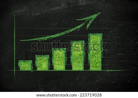 success of green economy: positive performance results with grass texture - stock photo